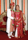 Happy Mood. An Indian couple dressed in traditional dress at the time of reception royalty free stock photography