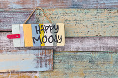 Happy or Moody sign board on wooden vintage background Stock Photography