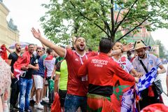 Moroccan football fans in the rain near Red Square in Moscow royalty free stock image