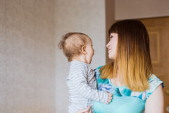 Happy mother with adorable baby boy indoors Royalty Free Stock Images