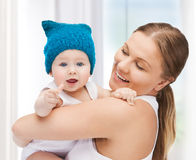 Happy mother with adorable baby Stock Photos