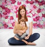 Happy mother with adorable girl and teddy bear Stock Photos