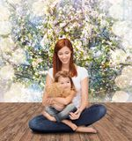 Happy mother with adorable girl and teddy bear. Childhood, parenting and relationship concept - happy mother with adorable little girl and teddy bear Royalty Free Stock Photography