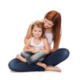 Happy mother with adorable little girl Stock Photos