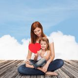 Happy mother with adorable little girl and heart Royalty Free Stock Photography