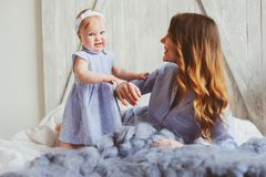 Free Happy Mother And 9 Month Old Baby In Matching Pajamas Playing In Bedroom In The Morning Stock Images - 103067944