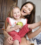 Happy Mother And Daughter In Bed, Smiling Hugging Royalty Free Stock Photography