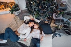 Free Happy Mother And Daughter Opening Christmas Gifts. Family Gathered Around A Tree At Home. Christmas Tree With Presents Royalty Free Stock Photo - 160622535