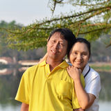 Happy Mother And Father In The Park Stock Photography