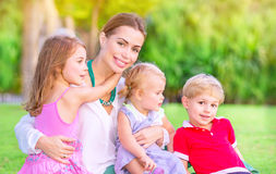 Happy mother with babies Stock Photo