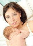 Happy mother with a baby Stock Images