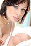 Happy mother with a baby Royalty Free Stock Photos