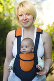 Mother carrying Baby Royalty Free Stock Image