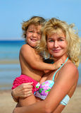 Happy mother with baby on beach Royalty Free Stock Images