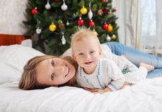 Happy mother and baby boy with Christmas tree Royalty Free Stock Image