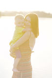 Happy Mother and baby boy cuddling Royalty Free Stock Photos