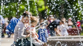 Happy Mother And Baby Boy Near Fountains In The Stock Images