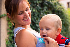Happy mother and baby boy outdoors Royalty Free Stock Images