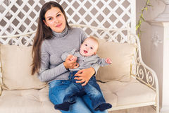 Happy mother with baby boy in the room Royalty Free Stock Image