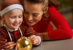 Mother and baby with christmas ball Stock Photography