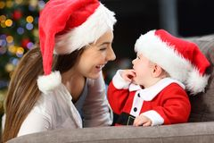 Happy mother and baby in christmas stock photos