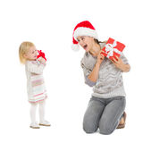 Happy mother and baby with Christmas present boxes Stock Photography