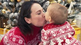 Loving mother and baby girl celebrating Christmas stock footage