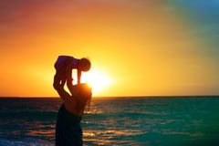 Happy mother and baby daughter play at sunset. Beach, parenting Royalty Free Stock Photos