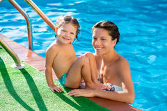 Happy mother and baby daughter swimming pool Stock Photos