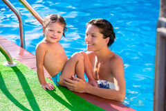 Happy mother and baby daughter swimming pool Royalty Free Stock Photo
