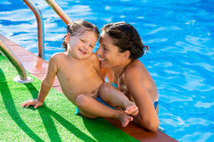 Happy mother and baby daughter swimming pool Stock Image