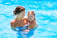 Happy mother and baby daughter swimming pool Royalty Free Stock Images