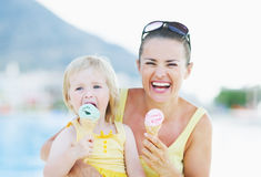 Happy mother and baby eating ice cream Stock Image