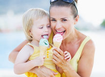 Happy mother and baby eating ice cream Royalty Free Stock Photography