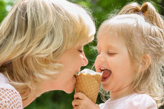 Happy mother and baby enjoy ice cream Stock Photos
