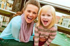 Happy mother and baby girl on bridge with grand cana royalty free stock photo