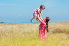 Happy mother and baby girl on the  field Stock Photography