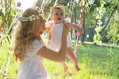 Happy mother and baby girl having fun outdoor Stock Images