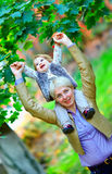 Happy mother and baby girl having fun in park Stock Photography