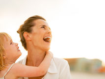 Happy mother and baby girl looking on copy space Royalty Free Stock Image