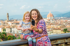 Happy mother and baby girl making selfie florence, italy Stock Photos
