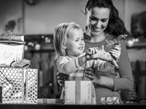 Happy mother and baby opening christmas presents. Happy mother and baby girl  opening christmas presents Royalty Free Stock Photography