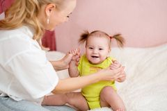 Happy mother  and baby have fun pastime Royalty Free Stock Image
