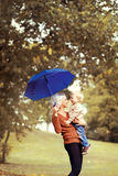 Happy mother and baby having fun in autumn Royalty Free Stock Image