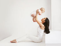 Happy mother and baby having fun together at home Stock Image