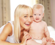 Happy mother with baby at home Stock Photography