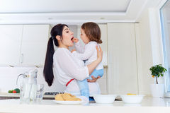 Happy mother and baby in the kitchen. royalty free stock photography