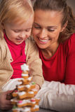 Happy mother and baby looking on cookie christmas tree Royalty Free Stock Photos