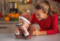 Happy mother and baby looking photos in camera Stock Photography