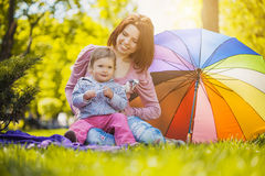 Happy mother and baby on the meadow Royalty Free Stock Image